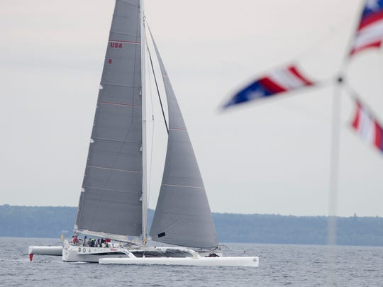 Arete crosses the finish line at 11:14 a.m. Sunday, July 17, 2016 and breaks the record for the first boat to the island for the Cove Island course in the Port Huron-to-Mackinac Island Sailboat Race. They finished with a time of 21 hours 44 minutes and 58 seconds. Arete broke the record last year for a time of 23 hours, 23 minutes and 51 seconds.