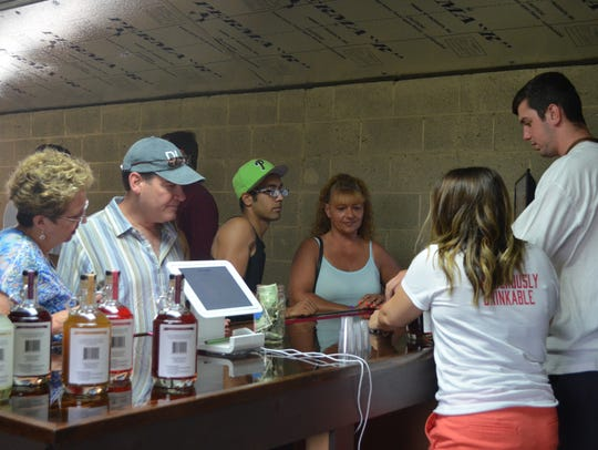 Visitors enjoy samples and make purchases of Jersey