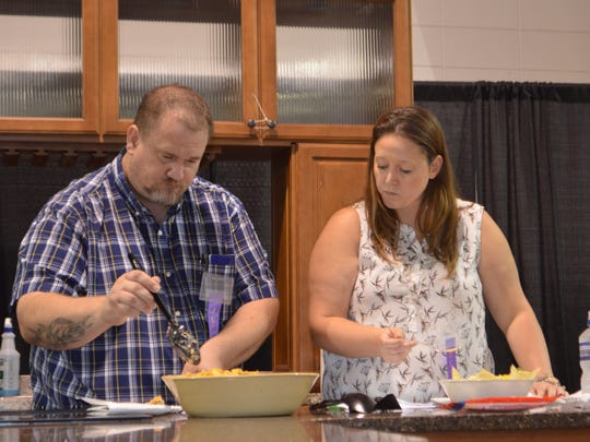 Jason Russell, owner of Tubby's Diner, and Ashley DeVore, family and consumer sciences teacher at Bolivar High School, taste entries during the Taco Tuesday competition at the Ozark Empire Fair.