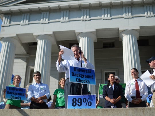 Sen. Michael Sirotkin, D-Chittenden, speaks in favor of universal background checks for gun sales, flanked by three leading Democratic candidates for governor and all Democratic candidates for lieutenant governor on Aug. 4, 2016, at the Statehouse in Montpelier.