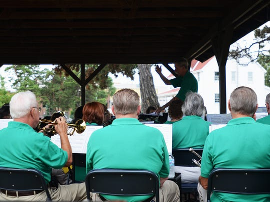 The New Horizons Band plays on the grounds of Fort Gratiot Light Station Sunday afternoon.