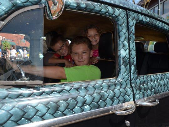 Aniello Sachetti, 10, sits behind the wheel and  his