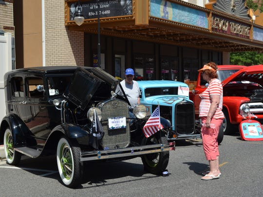 Barb Webb of Millville admires a Model A during the