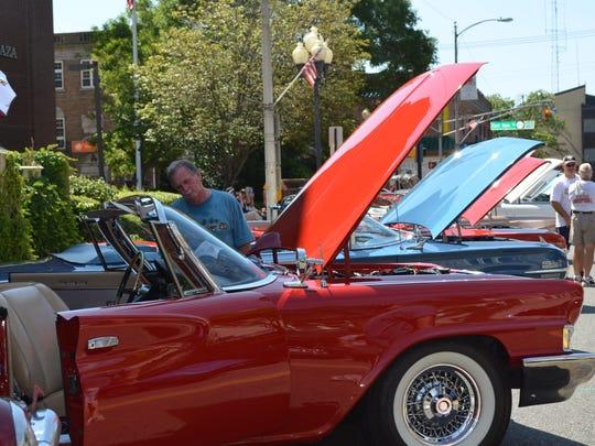 John Gardner of Sewell looks at a 1961 Chrysler 300G