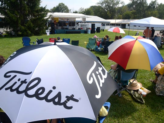 People try to stay out of the sun during the 2015 BlueChiliGrass Festival.
