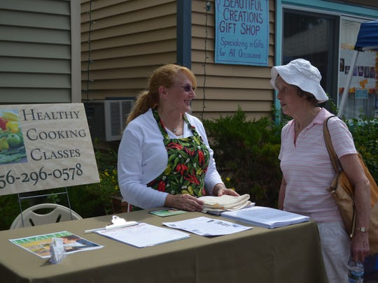 Patrecia Schwailik-Giunta of Vineland and Freya Dinshah of Malaga talk during the Vegstock vegan festival in Millville.