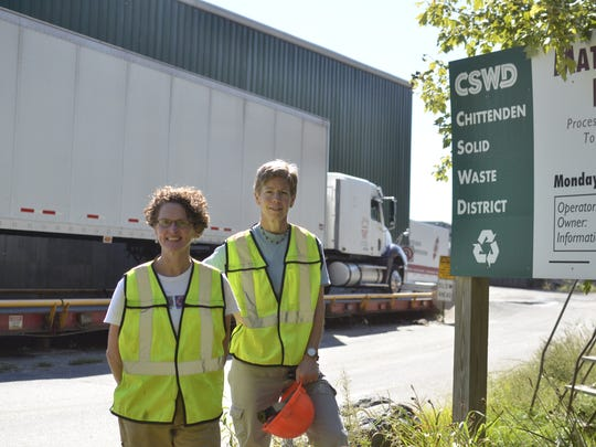 Michele Morris, right, assistant waste reduction manager and business outreach coordinator at the Chittenden Solid Waste District, stands with fellow CSWD staffer Robin Orr at the district's recycling facility in Williston. Morris works with businesses to encourage compliance with mandatory recycling laws.