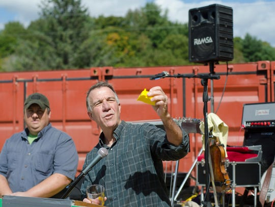 Phil Scott shows off a DuBois toy bulldozer given out