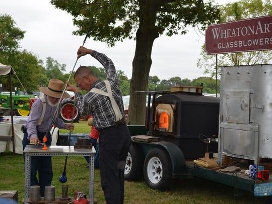 WheatonArts Traveling Glassblowers volunteers Frank