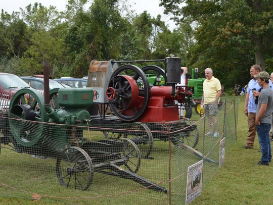 Visitors admire a 12hp Hettinger engine that was built