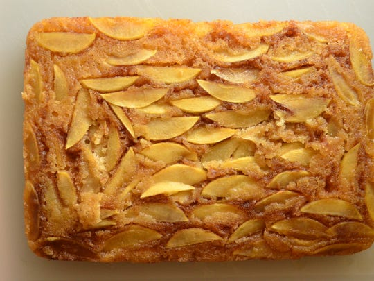 This Apple Upside-Down Cake is moist, buttery, and accented with cinnamon and apples. It's fall heaven.