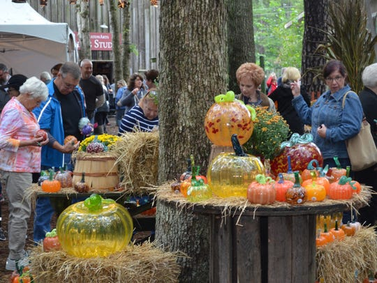 Visitors search through the glass pumpkin patch at