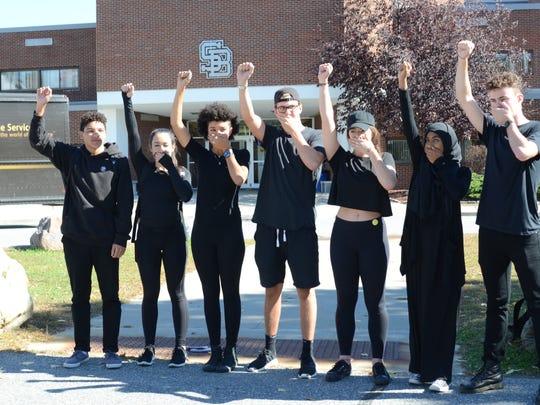 South Burlington High School Students stand outside