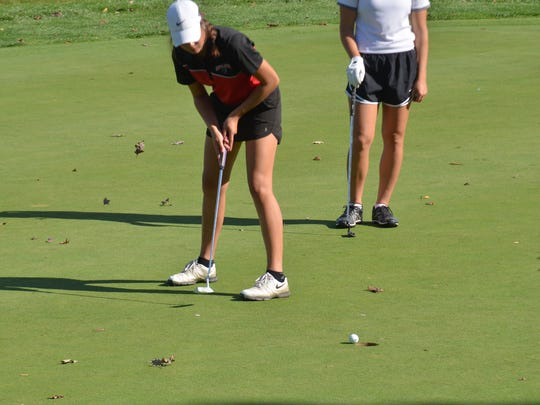 SPASH junior Jessica Barber drains a putt on her final