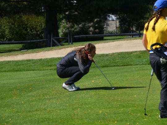 Shelby junior Claire Korbas sizes up a putt during