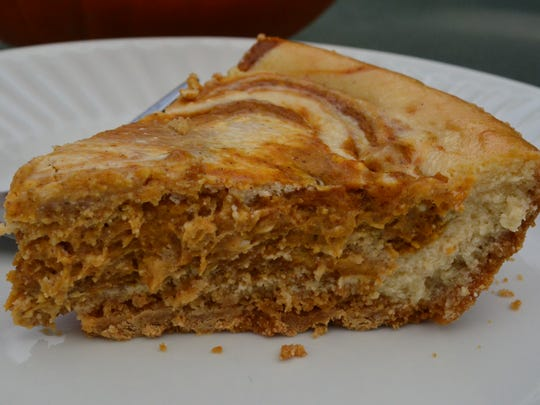 Pumpkin Swirl Cheesecake is a cross between cheesecake and pumpkin pie. It's marvelous.