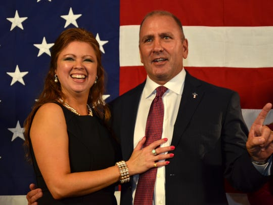 Clay Higgins and his wife, Becca, thank supporters at an election watch party at the Sizzling Monkey in Lafayette on 11-08-16.