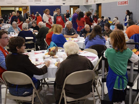 Community members eat a Thanksgiving meal at the Salvation Army Citadel in Port Huron.