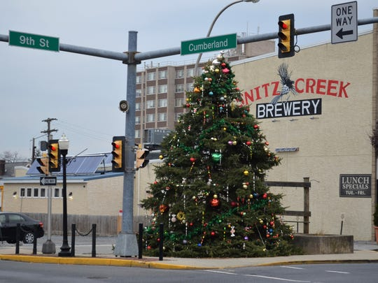 Lebanon Community Christmas Tree of 2016 stands at the corner of Ninth and Cumberland streets in Lebanon City. It was lit for the first time Friday night, Nov. 18.