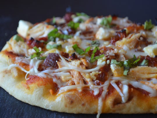 Carve this delicious pizza into little bites for your tapas party. It has chicken, bacon, sundried tomatoes and feta cheese. It's marvelous.
