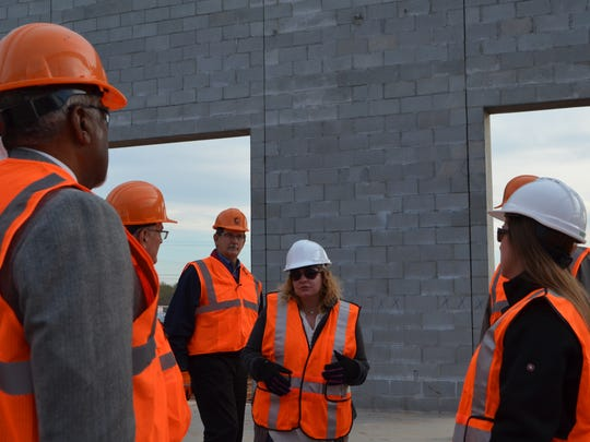 Michelle Wood, center, leads a school board tour of what will be the Wichita Falls ISD's Career Education Center in December 2016.