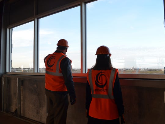 Wichita Falls ISD Superintendent Michael Kuhrt and school board trustee Elizabeth Yeager look out at the view of the city from the second floor of the Career Education Center. The facility is slated to be completed in the summer of 2017.