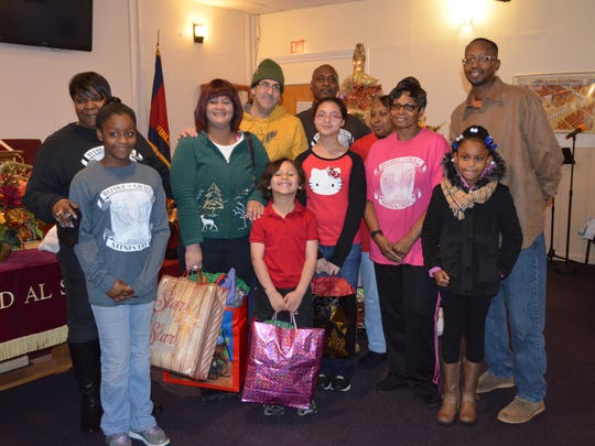 Members of Refuge of Grace Ministries in Vineland surround