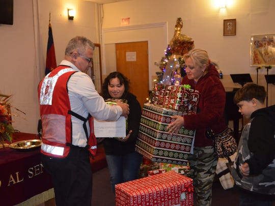 Salvation Army Major Miguel Barriera presents Christmas