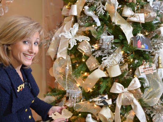 Donna Edwards smiles while showing off ornaments decorated