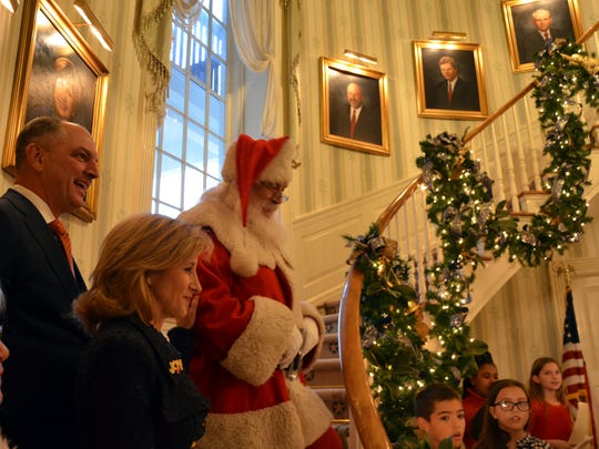 Governor Edwards, his wife Donna, Santa and Mrs. Clause