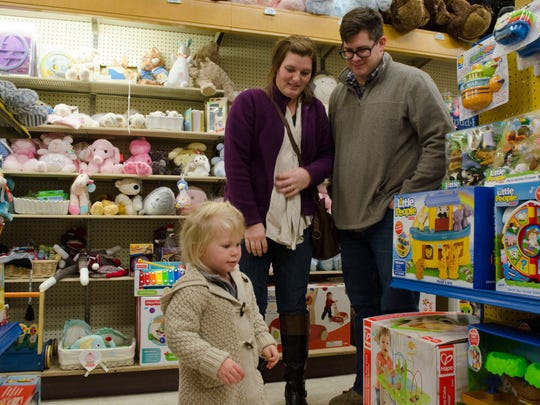 Customers look for last-minute gifts at Veach's Toy Station in downtown Richmond, Ind. on Tuesday, Dec. 20, 2016.