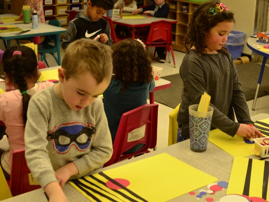 Liam and Tilda make art in Emily Stewarts' class at Integrated Arts Academy at H.O. Wheeler on Jan. 3, 2017.