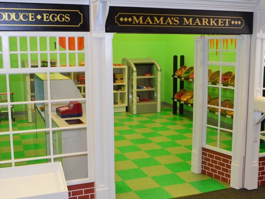 Children can go grocery shopping inside Mama's Market.