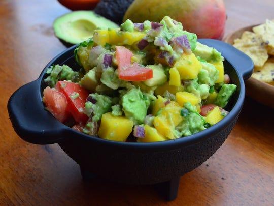 This gorgeous Mango Guacamole tastes as good as it