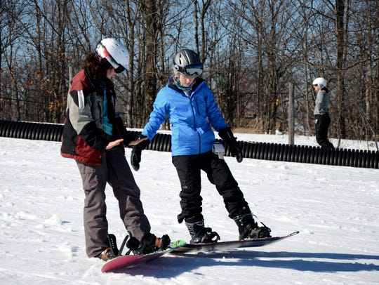 Indianhead Mountain instructor Sara McCormack (left)