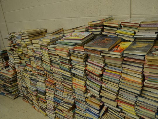 Thousands of books are seen Wednesday at the Wichita Falls Public Library. More than 3,000 books, mostly youth and children's books were damaged by water after a sprinkler head malfunctioned Tuesday.
