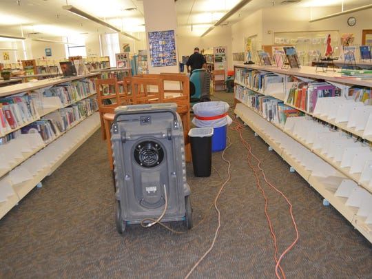 Bookshelves, many empty are seen Wednesday at the Wichita Falls Public Library. A sprinkler malfunction February 28 caused water damage to thousands of books and some damage to walls, floors and carpet.