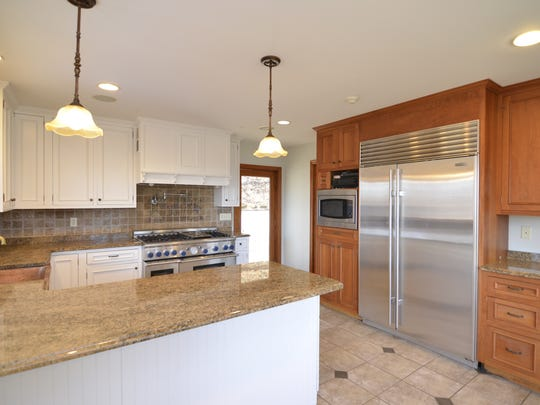 The sheen of polished granite give kitchens a high-end look without breaking the bank. This home is on Route 9W in Upper Nyack.