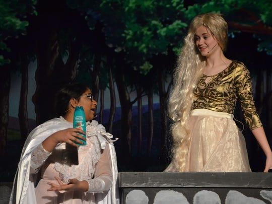 The Enchantress (Pravallika Chirumamilla) offers hair care tips to Rapunzel (Ally Denooyer).