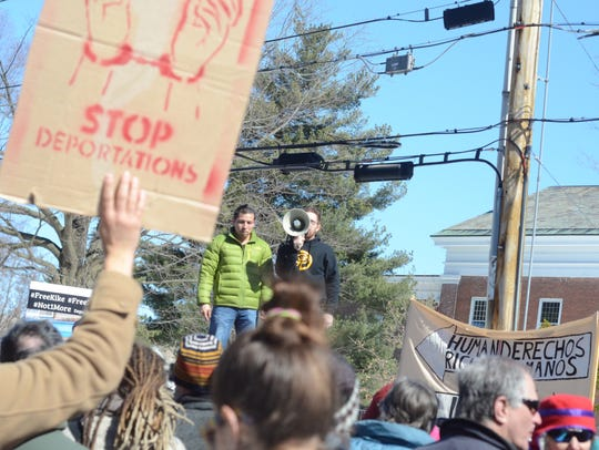 A rally against arrests of Vermont dairy workers by