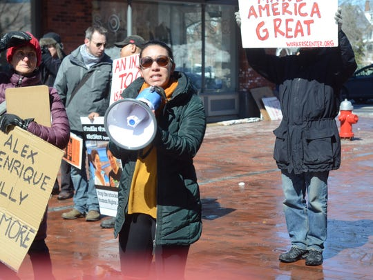 Rep. Kesha Ram speaks at a rally against the arrests