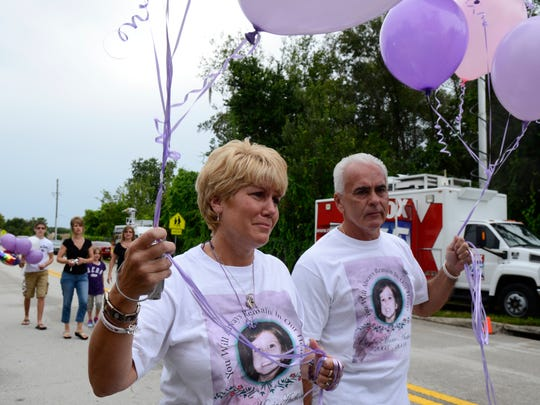 Cindy Anthony, left, and George Anthony, right, arrive