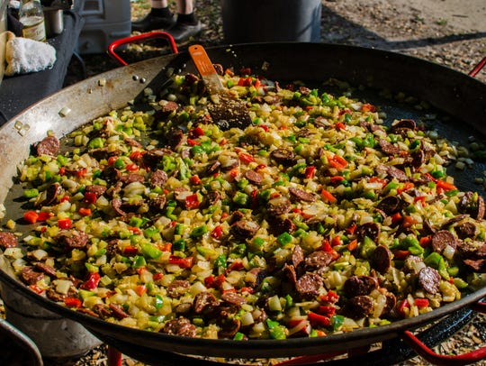 Chef Frank Taylor's seafood paella simmers during Repast.