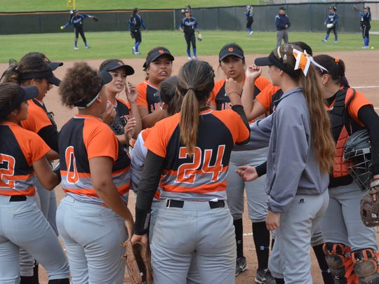 The Ventura College softball team huddles before knocking off first-place Hancock on Thursday in Ventura.