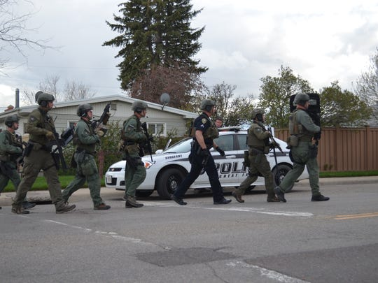 The Great Falls Police Department's High Risk Unit used breaching devices, gas canisters, a battering ram and a ladder Monday night in a standoff on Smelter Avenue Northwest.