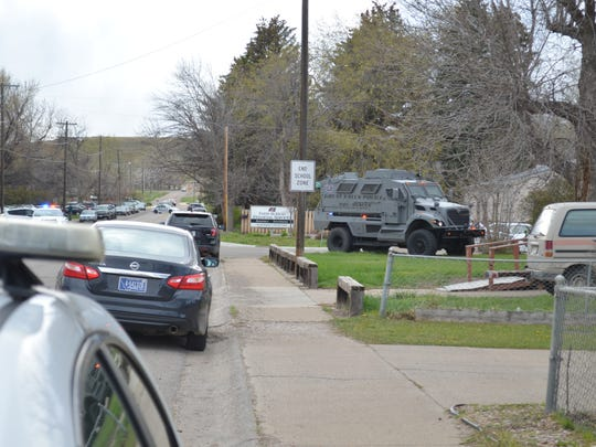 The Great Falls Police Department's MRAP arrived brought the first wave of the department's high risk unit officers. The vehicle was immediately driven onto the lawn of the home where Carmen Gopher refused to come into custody.
