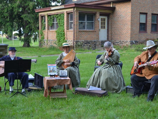 The Piney Hollow Drifters will perform during Camp-by-Candlelight