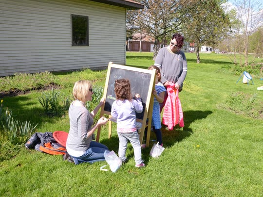 Kelly Wine, an early childhood specialist, helps a