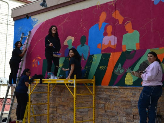 Ingrid Morales, far right, and her team of New Brunswick High School students from its Art Honor Society paint a mural that will be unveiled 6 to 8 p.m. May 18 at Las Cazuelas, 114 French St. Also pictured from left to right are Brandy Raviela, Jennifer Acosta, Wendy Abrego, and Michelle Juarez.