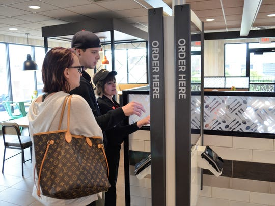 Customers use a new digital kiosk to order at McDonald's in Cape May Courthouse.